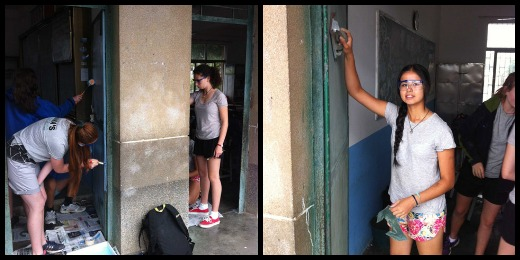 Hard at work - sanding and painting the doors at the local primary school